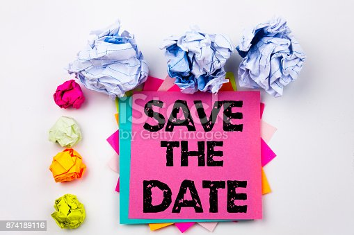 istock Writing text showing Save The Date written on sticky note in office with screw paper balls. Business concept for Special Day and Greeting on the white isolated background. 874189116