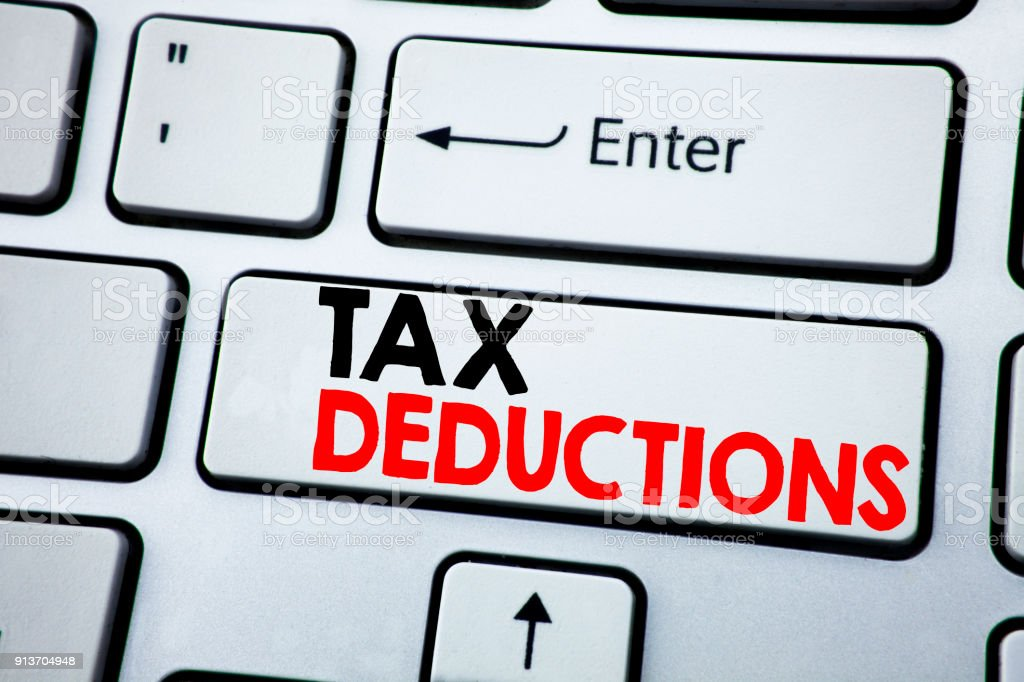 Writing text showing Tax Deductions. Business concept for Finance Incoming Tax Money Deduction written on white keyboard key with copy space. Top view. stock photo