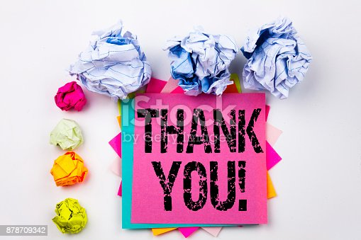 1068057246 istock photo Writing text showing Thank You written on sticky note in office with screw paper balls. Business concept for Giving Gratitude Appreciate Message on the white isolated background. 878709342