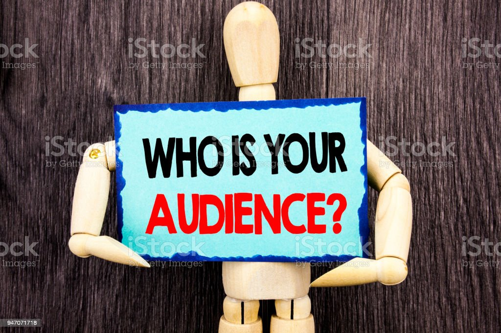 Writing text showing  Who Is Your Audience Question. Concept meaning Customer Target Service Client Research written on Sticky Note Holding By Sculpture on the wooden background. stock photo