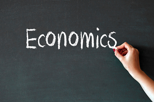 Writing The Word Economics On A Blackboard Stock Photo - Download Image Now  - iStock