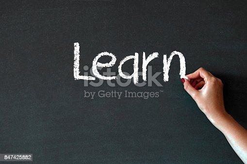 1094837778 istock photo Writing the word Learn on a blackboard 847425882
