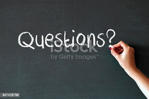 Question written on chalkboard blackboard. Hand writing with chalk great texture