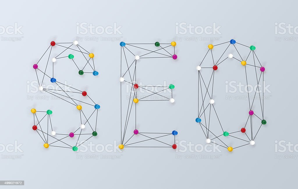Writing the word SEO by using pins and strings. stock photo
