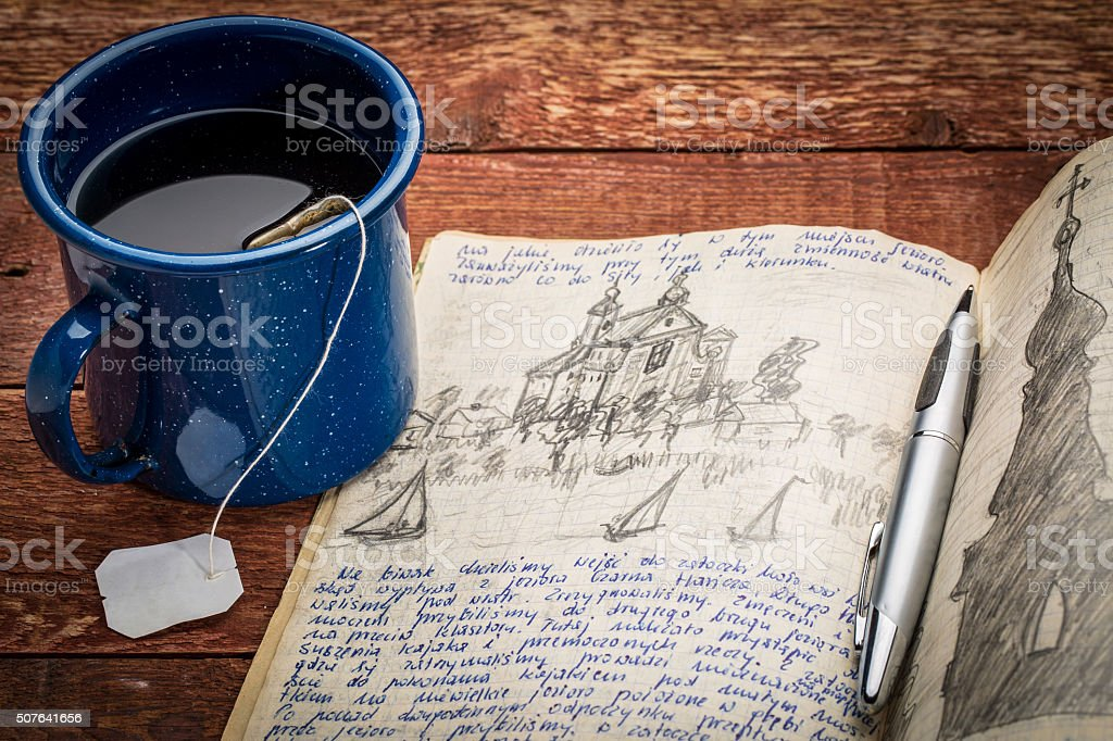 writing travel journal stock photo