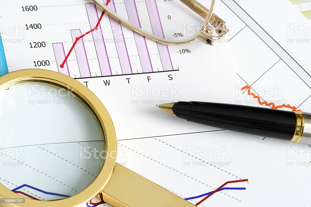 Writing Utensils on Financal Documents royalty-free stock photo