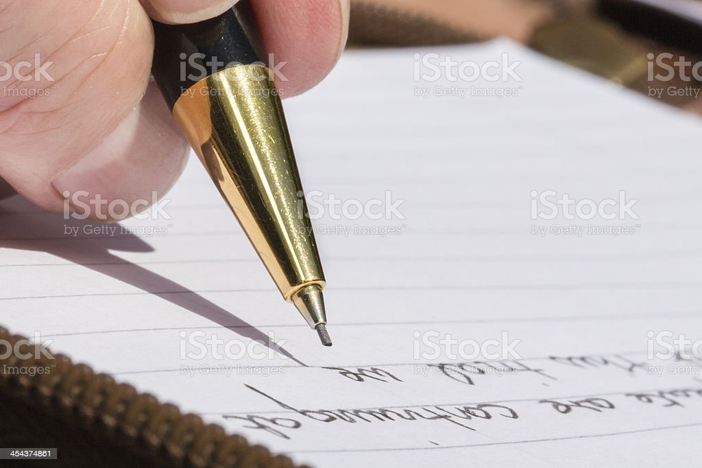Writing with a mechanical pencil royalty-free stock photo