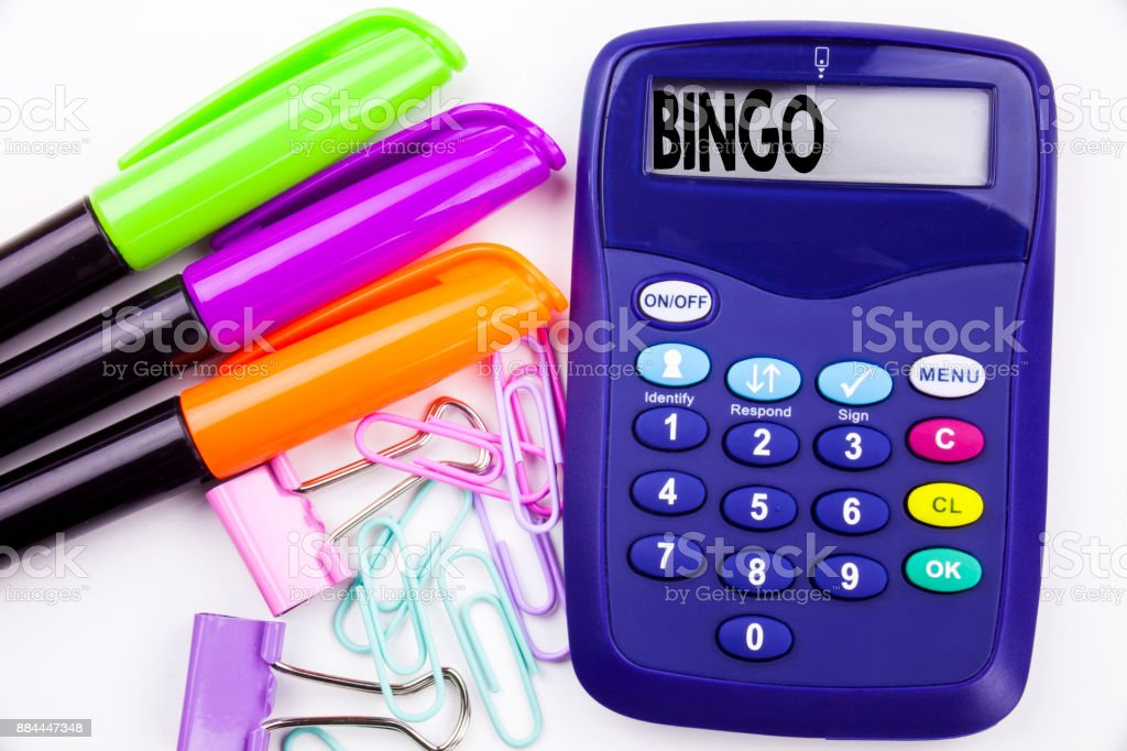 Writing word Bingo text in the office with surroundings such as marker, pen writing on calculator. Business concept for Lettering Gambling to Win Price Success white background with copy space stock photo