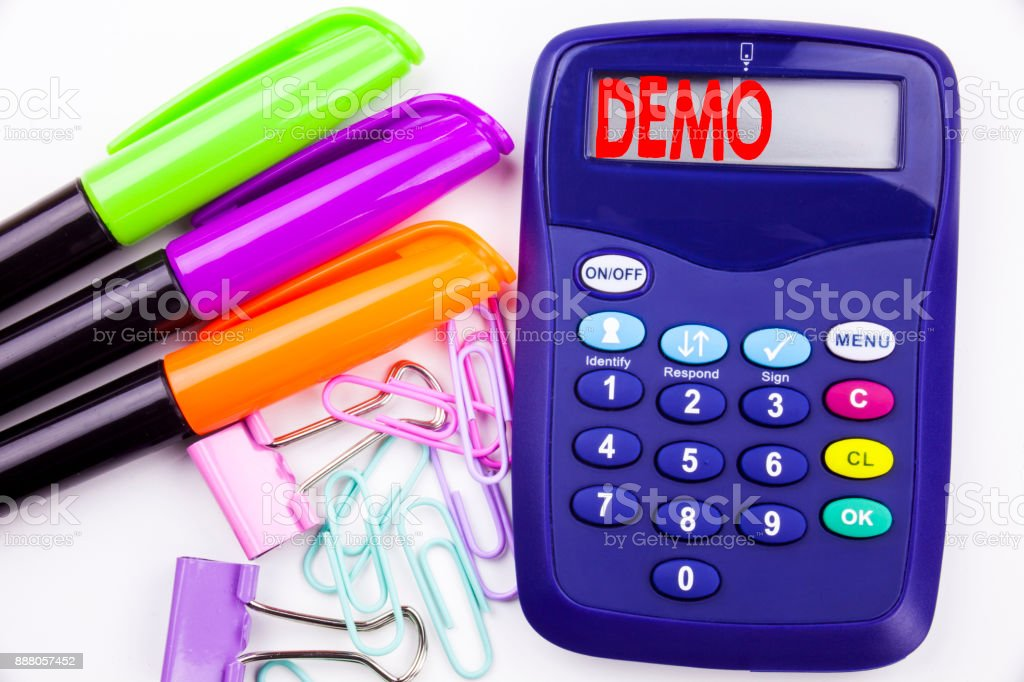 Writing word Demo text in the office with surroundings such as marker, pen writing on calculator. Business concept for Software Demonstration white background with copy space stock photo