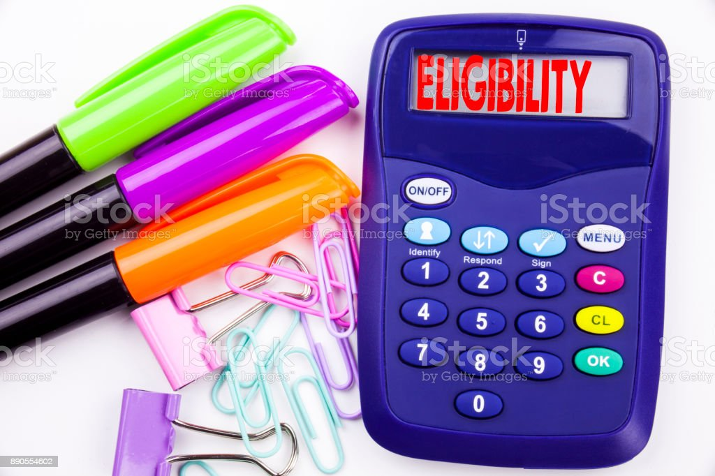 Writing word Eligibility text in the office with surroundings such as marker, pen writing on calculator. Business concept for Suitable Eligible Eligibility white background with copy space stock photo