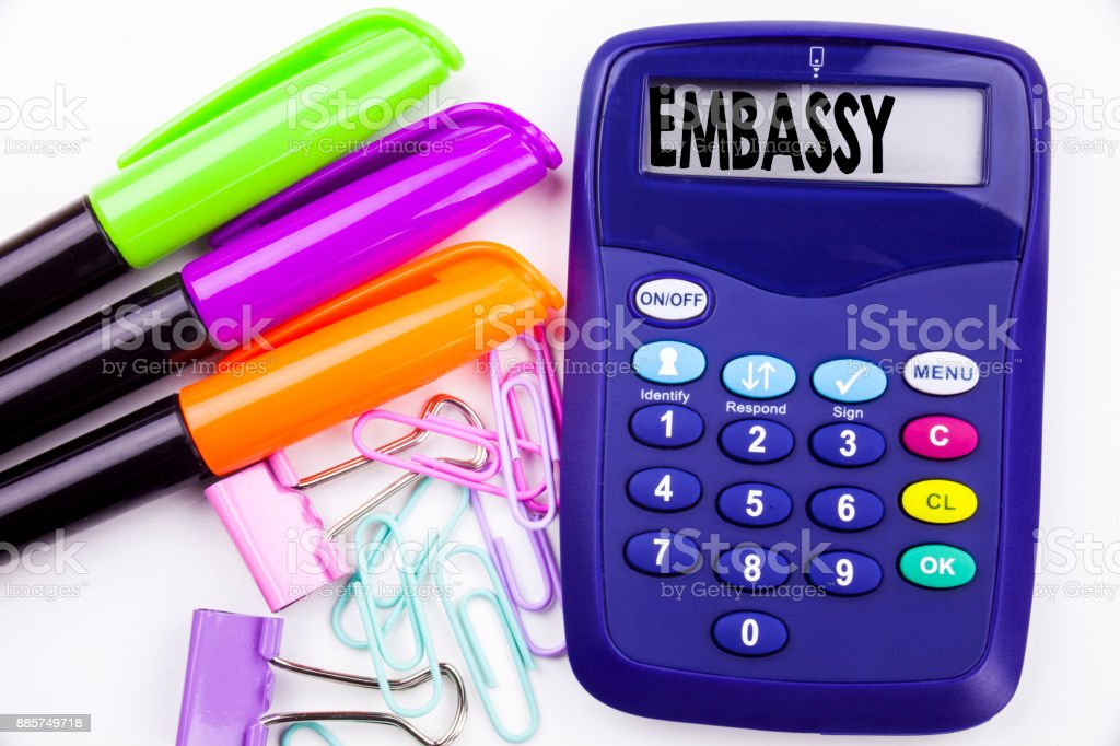Writing word Embassy text in the office with surroundings such as marker, pen writing on calculator. Business concept for Tourist Visa Application white background with copy space stock photo