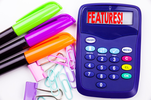 istock Writing word Features text in the office with surroundings such as marker, pen writing on calculator. Business concept for Advertisement Advertising white background with copy space 887664726