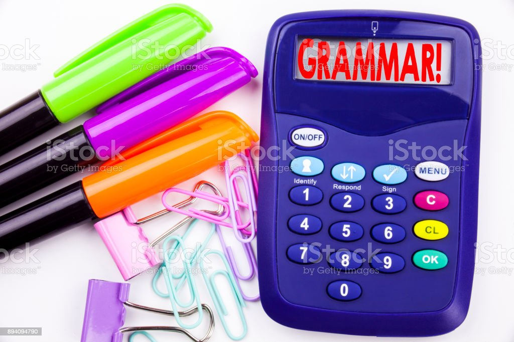 Writing word Grammar text in the office with surroundings marker, pen writing on calculator. Business concept for  The Basic Rules of Syntax Grammatical Language white background with copy space stock photo