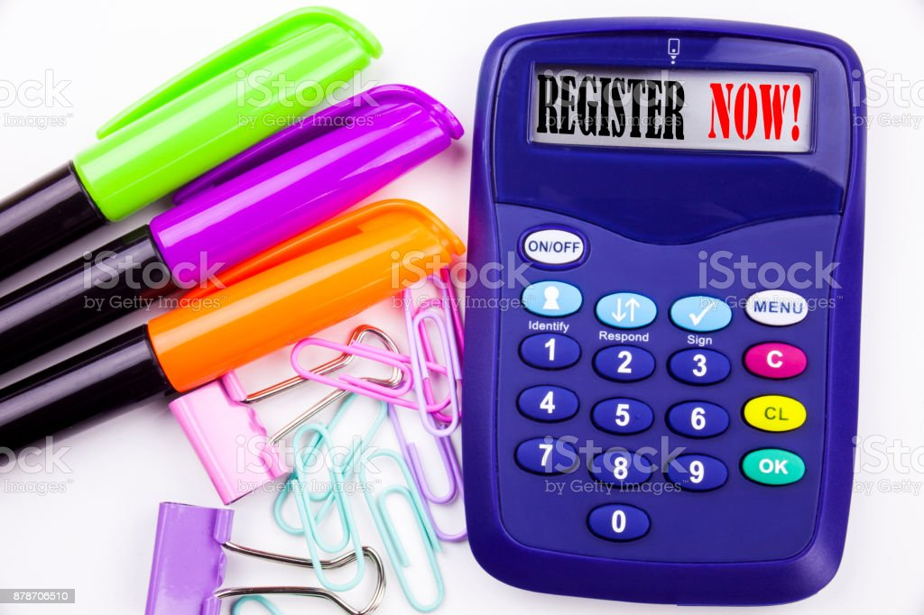 Writing word Register Now text in the office with surroundings such as marker, pen writing on calculator. Business concept for Internet Registration Subscribe white background with copy space stock photo