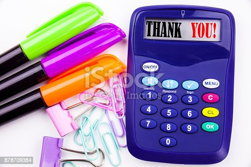 1068057246 istock photo Writing word Thank You text in the office with surroundings such as marker, pen writing on calculator. Business concept for Giving Gratitude Appreciate Message white background with copy space 878709384