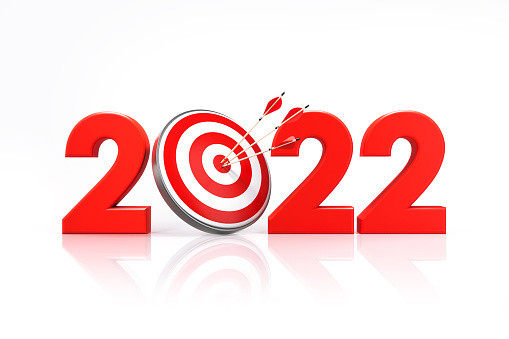 2022 written by red bull's eye target on white background. Horizontal composition with copy space. 2022 resolutions concept.