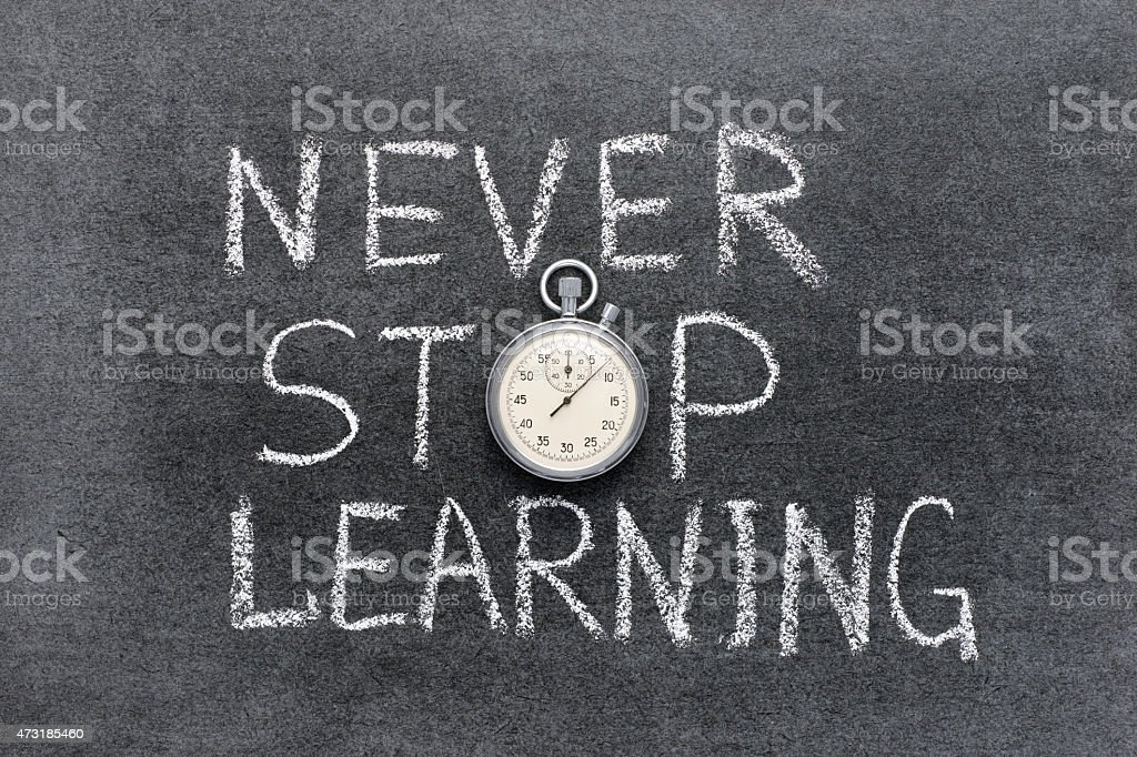 NEVER STOP LEARNING written in chalk, the O is a stopwatch stock photo