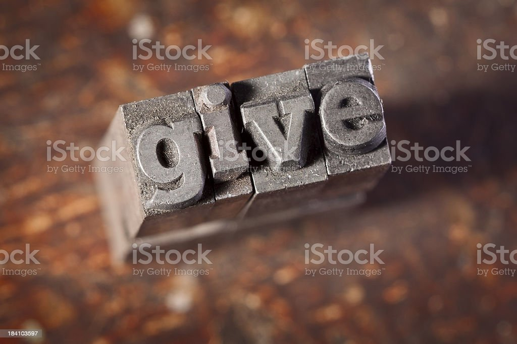 GIVE written in letterpress on old wood background royalty-free stock photo