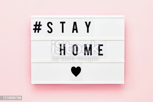 istock STAY HOME written in light box on pink background. Healthcare and medical concept. Top view. Quarantine concept. 1213593758