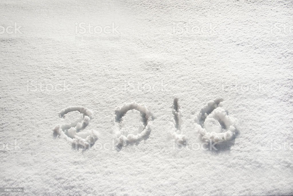 2016 written in snow, holiday background stock photo