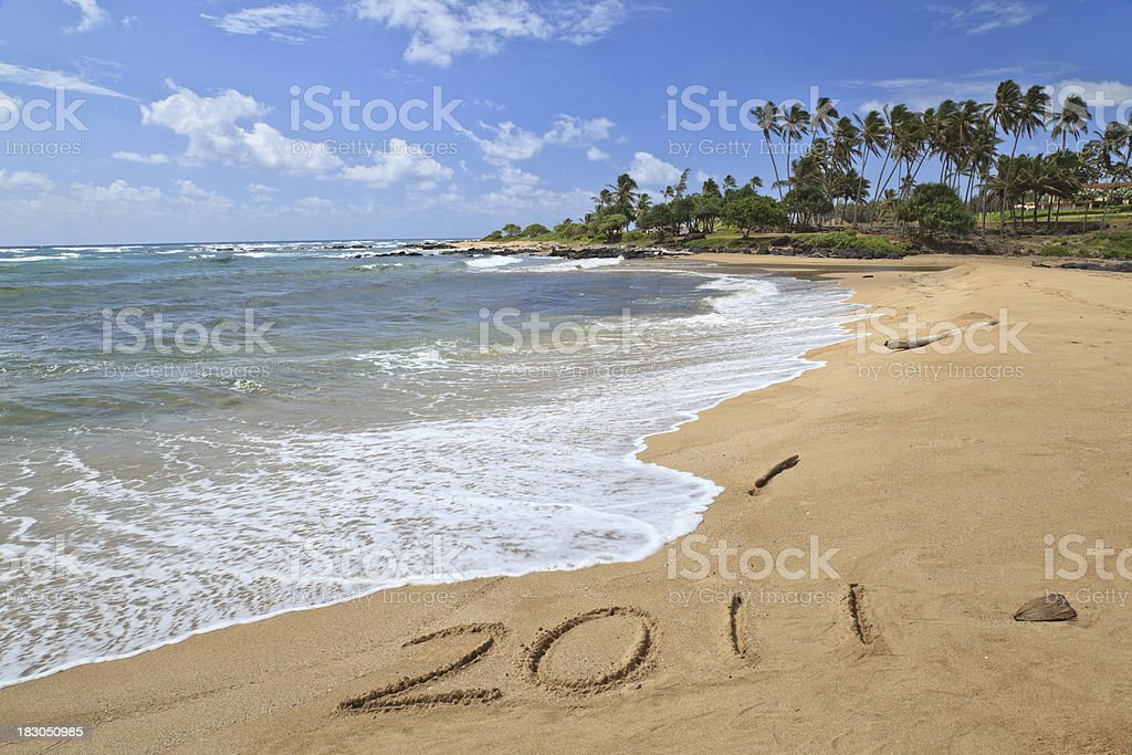 2011 written in the sand stock photo