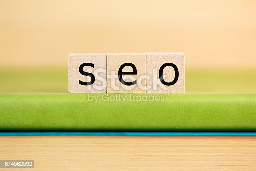 istock SEO written in wooden cubes on a green book 874562592