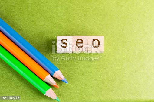 istock SEO written in wooden cubes with colored pencils on a green background 874102378