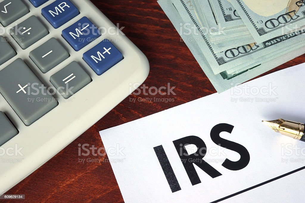 IRS written on a paper. Financial concept. stock photo
