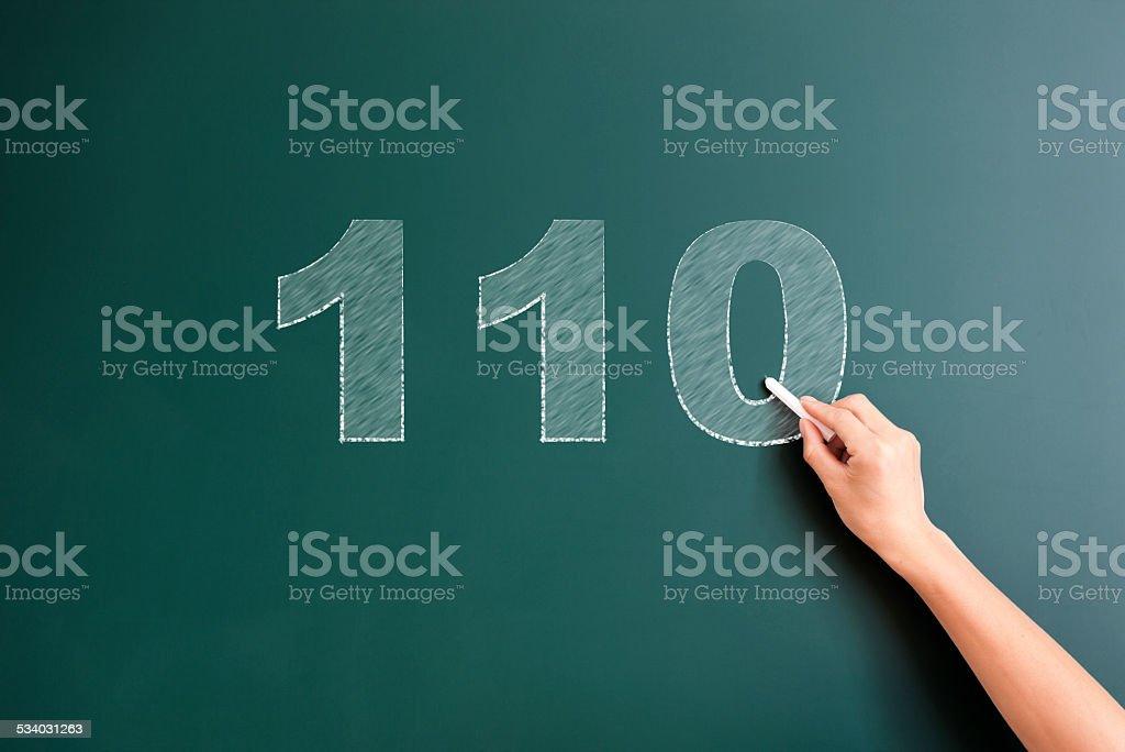 110 written on blackboard stock photo
