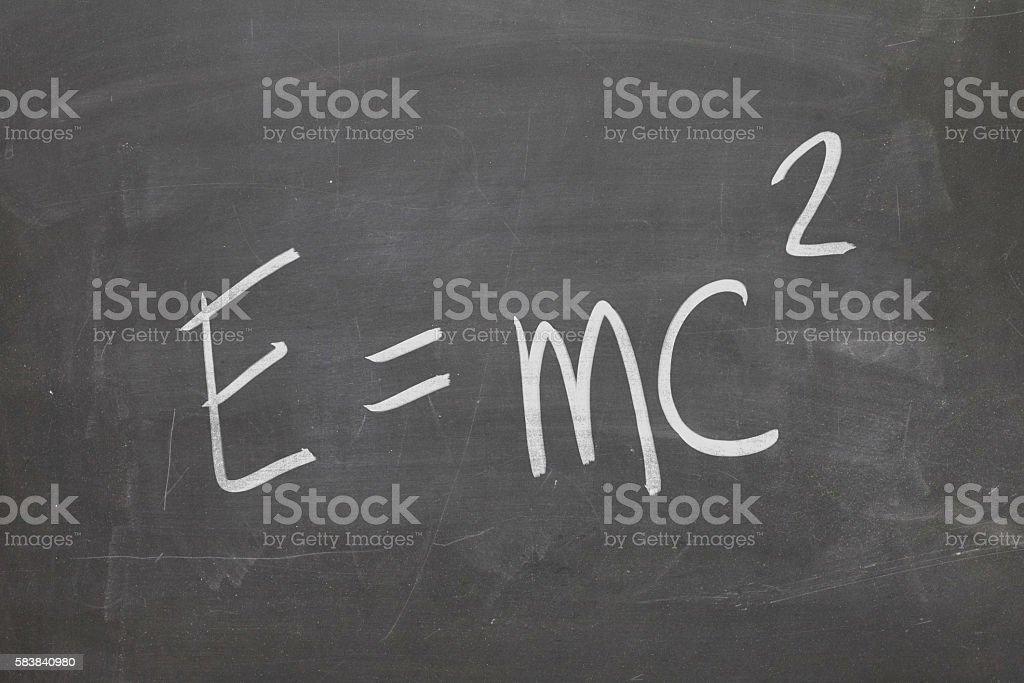 E=MC2 written on blackboard stock photo