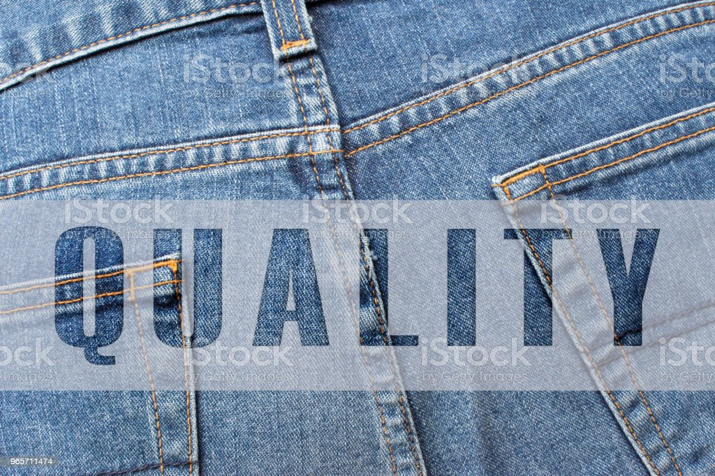 QUALITY written on blue jeans - Royalty-free Advertisement Stock Photo