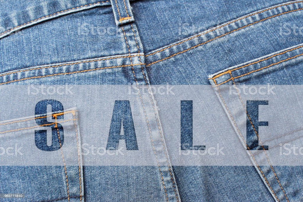 SALE written on blue jeans - Royalty-free Advertisement Stock Photo