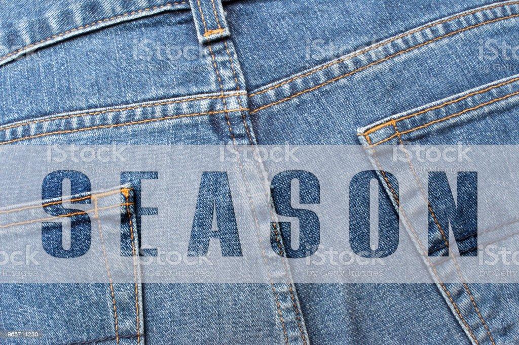 SEASON written on blue jeans - Royalty-free Advertisement Stock Photo