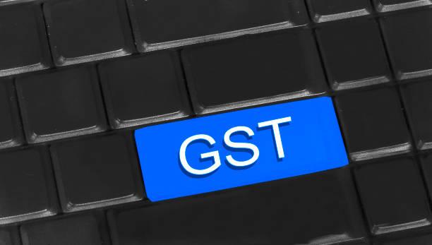 GST written on keyboard stock photo