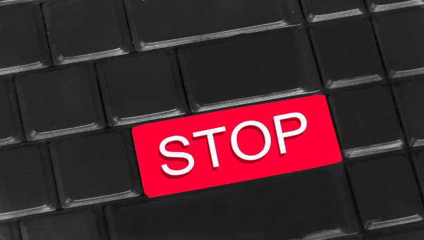 STOP written on keyboard stock photo