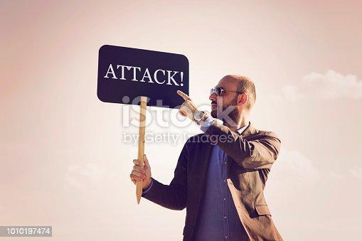 istock ATTACK written on small blackboard. 1010197474