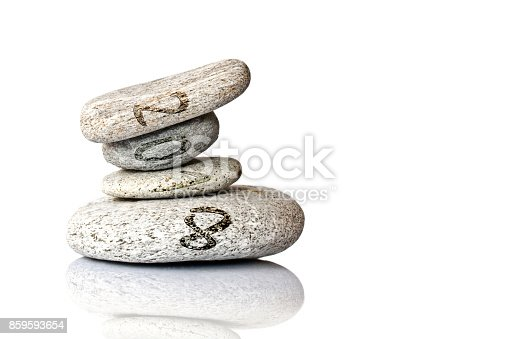 istock 2018 written on stack of pebbles isolated on white background 859593654