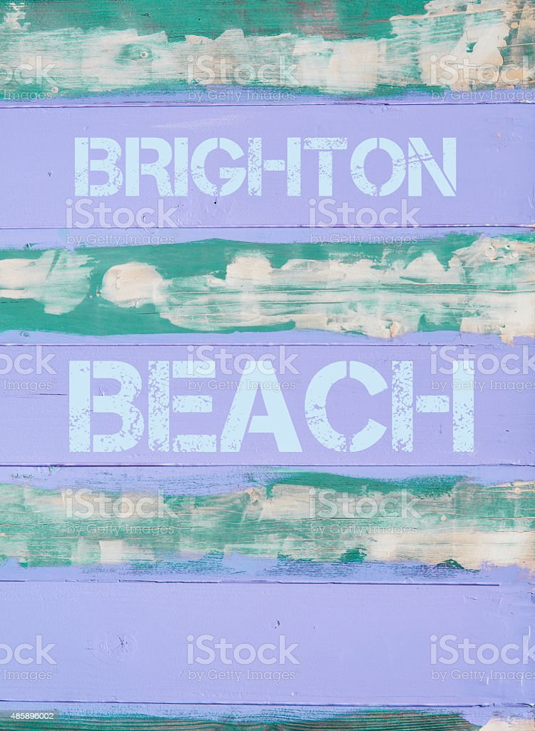 BRIGHTON BEACH written on vintage painted wooden wall stock photo