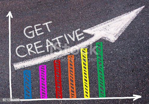 istock GET CREATIVE written over colorful graph and rising arrow 621234420