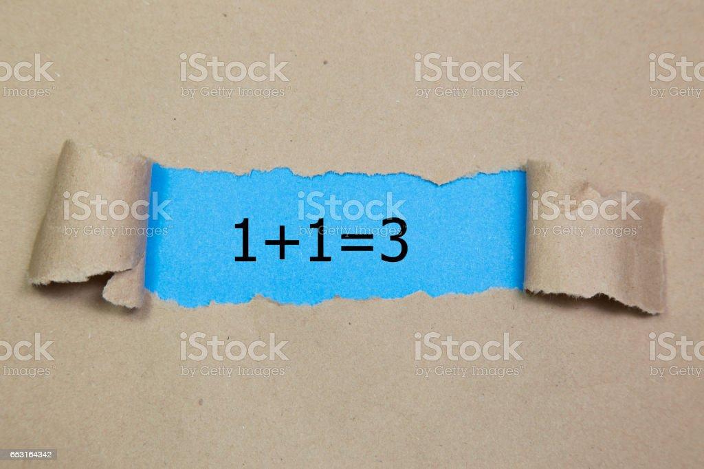 1+1=3 written under torn paper. Business, technology, internet concept. stock photo