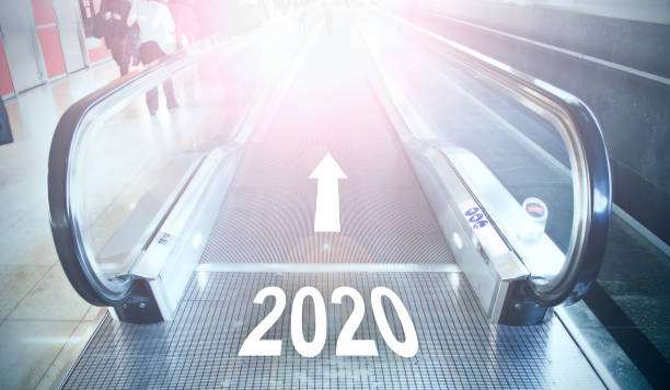 2020 written walkway escalator in airport terminal stock photo