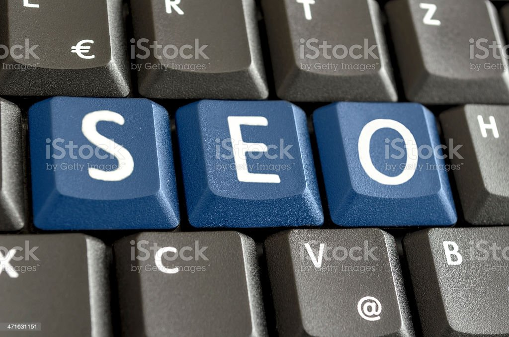 SEO written with blue keyboard buttons royalty-free stock photo