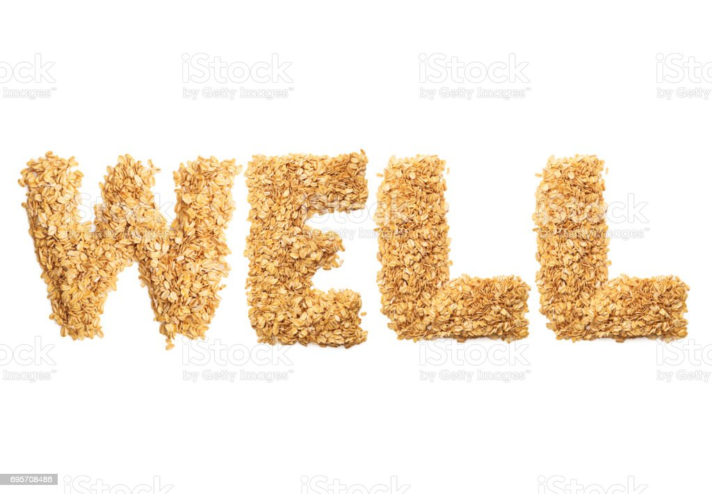 'WELL' written with oat grains word. Shape of oatmeal flakes on isolated white background stock photo