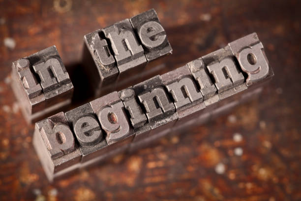 IN THE BEGINNING Written With Old Letterpress stock photo