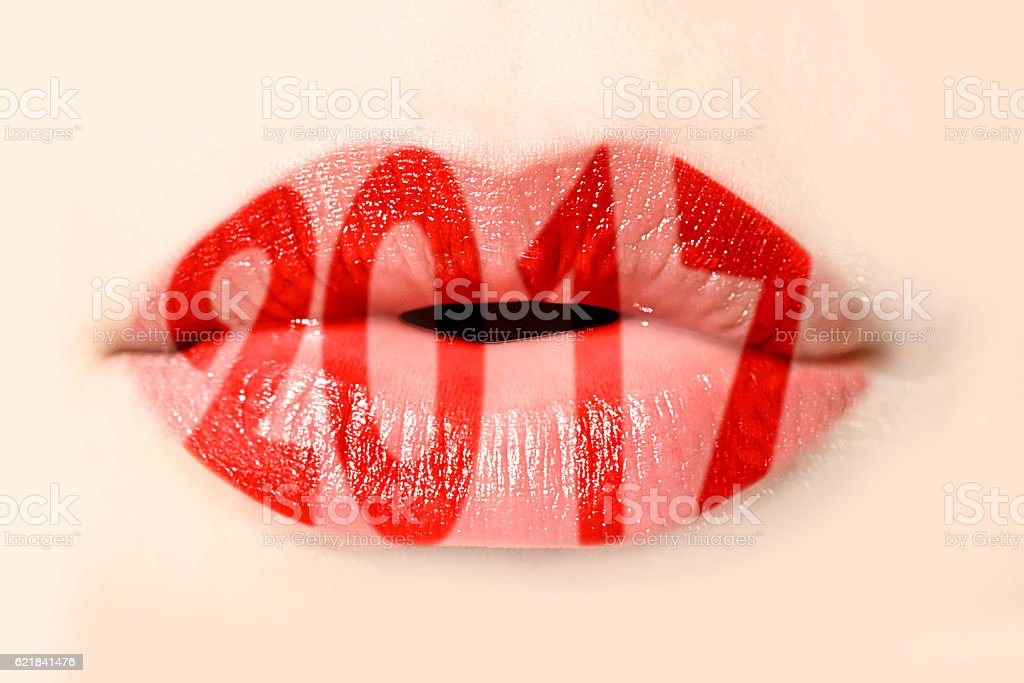 2017 written with red lipstick on girl lips stock photo