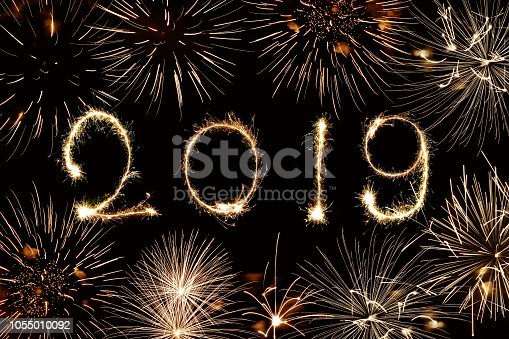 1070880528 istock photo 2019 written with sparkles and fireworks 1055010092