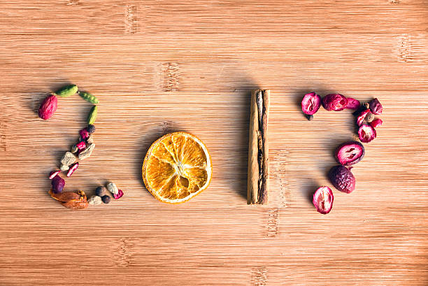 2017 written with spices on wooden background, food 2017 - zimt vorteile stock-fotos und bilder