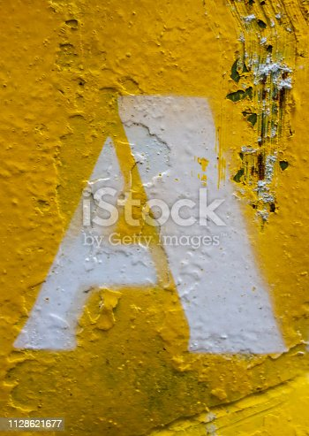 184953872istockphoto Written Wording in Distressed State Typography Found Letter A 1128621677