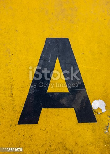 184953872istockphoto Written Wording in Distressed State Typography Found Letter A 1128621679