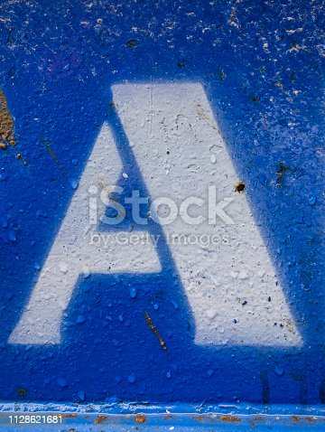 184953872istockphoto Written Wording in Distressed State Typography Found Letter A 1128621681